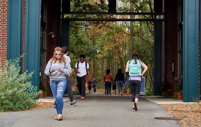 Students walking on campus walkway.